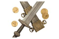 Replica Roman Dagger and Denarii - stock photo