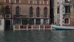 Climate change: partially submerged canal house in venice, italy at high tide Stock Footage