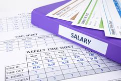 Employee time sheet and salary binder Stock Photos