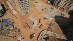Aerial shot.Construction from top point.  Construction materials trucks Stock Footage