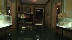Global warming economic impacts: submerged shop interior in venice at high tide Stock Footage