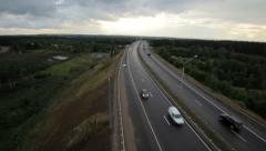 Aerial shot of country highway at sunset Stock Footage