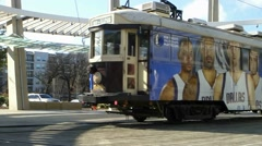 Trolley featuring the Dallas Mavericks NBA season 2014/15 leaving Uptown Station Stock Footage