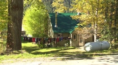 Mountain cabin, laundry on the line Stock Footage