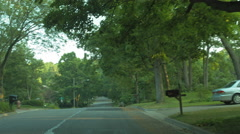 Driving plate: Mid West upscale neighborhood, front view 1 4K Stock Footage