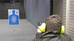 4K Man Shooting Gun Range Practice Stock Footage