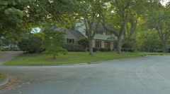 Driving plate: Mid West upscale neighborhood, rear view 3 4K Stock Footage