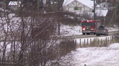 Fire truck through frame sirens, grey winter day Stock Footage
