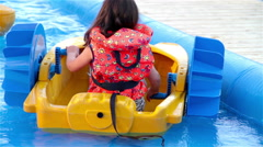 Little Girl Playing With A Boat In Summer - stock footage