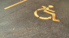 Parking lot fuel spill, reveal from handicap spot Stock Footage