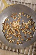 Roasted pine nuts in a pan Stock Photos