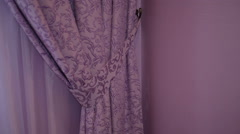 Beautiful purple curtains in the interior - stock footage