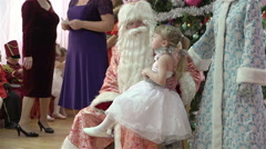 Little girl talks loudly on the representation of Santa Claus poem - stock footage