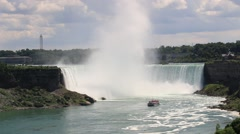 Niagara Falls with catamaran tour boat Stock Footage