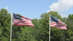 Two U.S, Flags flying Stock Footage