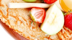 Baked and fruits : pancake with honey and strawberries Stock Footage
