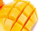 Carved mango isolated over white Stock Footage