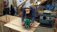 Man Using Router and Jig in Wood Shop Stock Footage