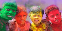 Holi celebrations - Group of kids playing Holi in India. Stock Photos