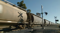 Freight Train Carriages Passing By A Railway Crossing Stock Footage