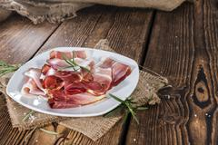 plate with sliced ham - stock photo