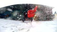 Teenager dancing breakdance in snow, slowmotion Stock Footage