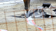 Jackhammer machine digging up concrete road Stock Footage