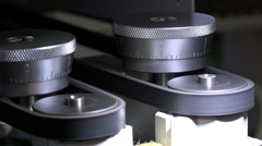 Belt drive for rotating rolls lathe in motion adjustment with scale grandmother - stock footage