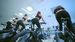 Beautiful sport ass on a stationary bike Stock Footage