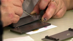 Man sorts of gold and ruby elements - components of the movement Stock Footage