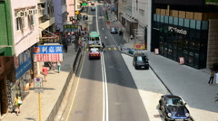 Time Lapse of Pedestrians, Buses and Traffic in Central District Hong Kong Stock Footage