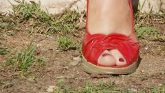 Feet lifestyle rock red shoes travelling shot Stock Footage