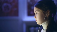 Portrait of child used the computer at night. Model Elizabeth Andreeva Stock Footage