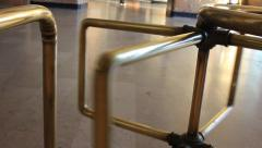 Brass turnstile in station building Stock Footage