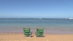 Empty Beach Chairs on Tropical Beach Stock Footage