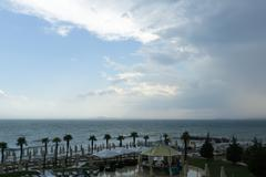 the cloudy sky and the coastline before an approaching storm - stock photo