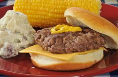 home cooked cheeseburger - stock photo