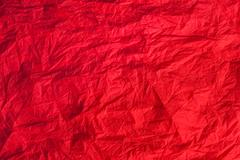 red crumpled paper, can be used as background - stock photo