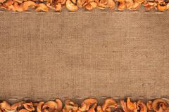 dried apple  were lying on sackcloth - stock photo