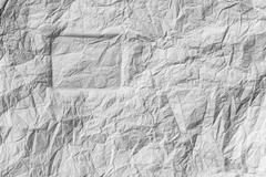 Stock Photo of silhouette of the rectangle on a white crumpled paper