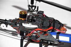 closeup of radio controlled helicopter parts. without canopy. - stock photo