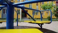 Merry-go-round on a childrens playground Stock Footage