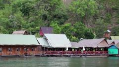 Bungalows on the Kwai river in northwestern Thailand Stock Footage