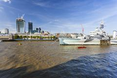 View over the thames river in london to the city with the hms belfast in the  Stock Photos