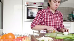 Woman cooking  vegetables to prepare healthy dinner.  woman is cooking in the Stock Footage