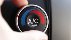 Turning Car AC to Cool Stock Footage