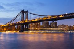 The manhattan bridge and skyline in new york city at night Stock Photos