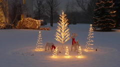 Home With Festive Outdoor Christmas/Holiday Lighting and Snow Stock Footage