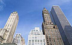 Skyscrapers at grand army plaza near central park in new york with deep blue  Stock Photos
