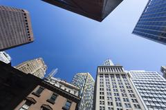 Low angle view of skyscrapers in the financial district of new york, usa Stock Photos